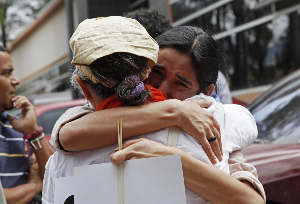 People embrace as they wait for the arrival of the body of slain Honduran indigenous leader and environmentalist Berta Cáceres, outside the coroners office in Tegucigalpa, Honduras. CREDIT: AP PHOTO/FERNANDO ANTONIO