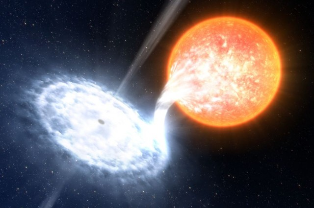 An artist's rendition of a black hole devouring a nearby star.