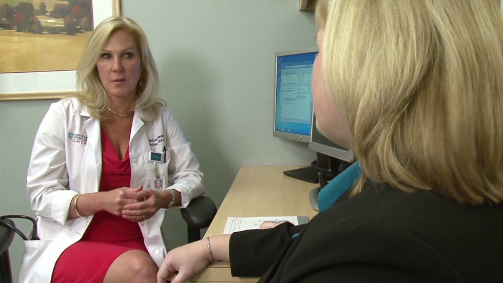 Dr. Wood discusses with a patient the cause of her heart attack