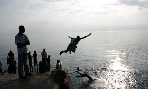 Men diving into Lake Kivu, Rwanda