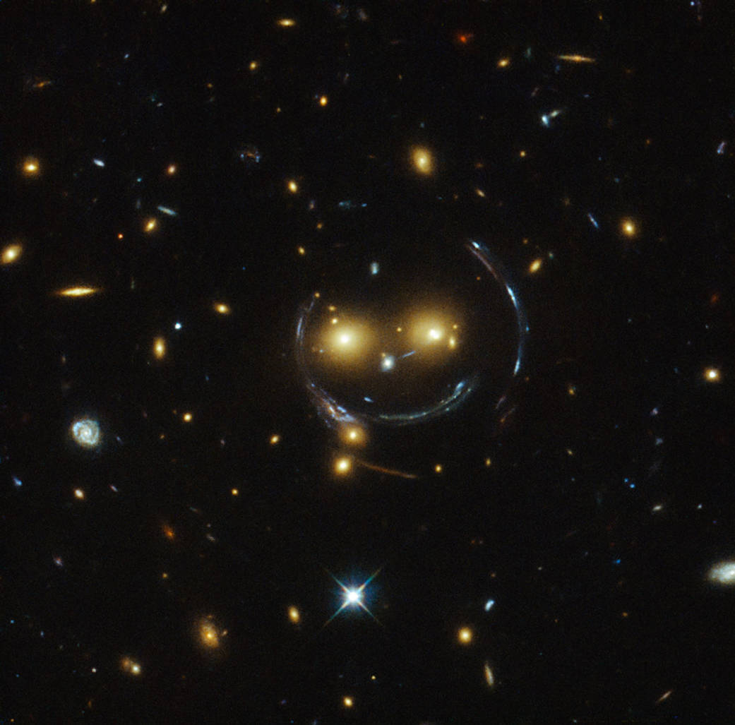 The galaxy cluster SDSS J1038+4849 - and it seems to be smiling.