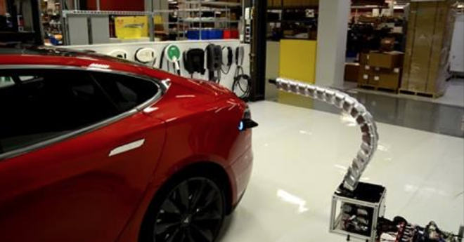 Tesla has designed a robotic arm that can automatically hook up to its electric cars for charging.