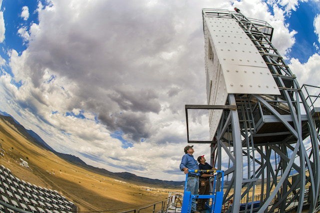 Researchers inspect the Falling Particle Receiver atop the National Solar Thermal Test Facility at Sandia National Laboratories