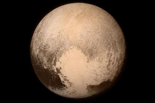 Pluto just before the historic fly-by on Tuesday.