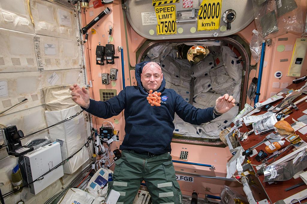 A healthy snack floats toward astronaut Scott Kelly aboard the International Space Station