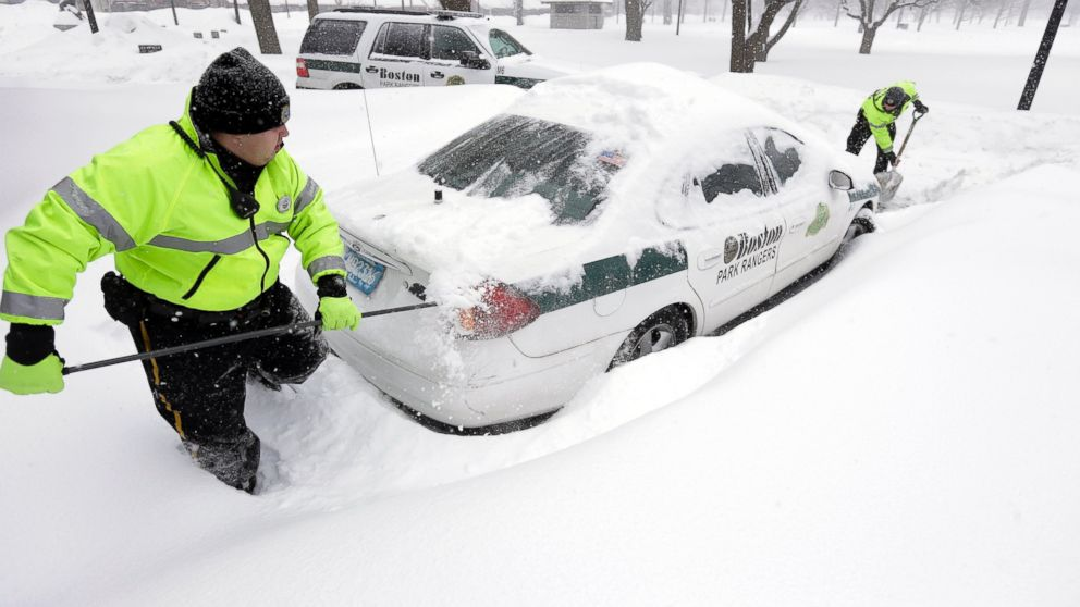 Park Rangers in Boston dig out after a massive snow storm in January 2015