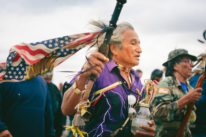 Phil Little Thunder Sr., from the Rosebud reservation in South Dakota, carries water from his hometown for the sacred ceremony to the burial ground in North Dakota. Photo: Alyssa Schukar for The New York Times