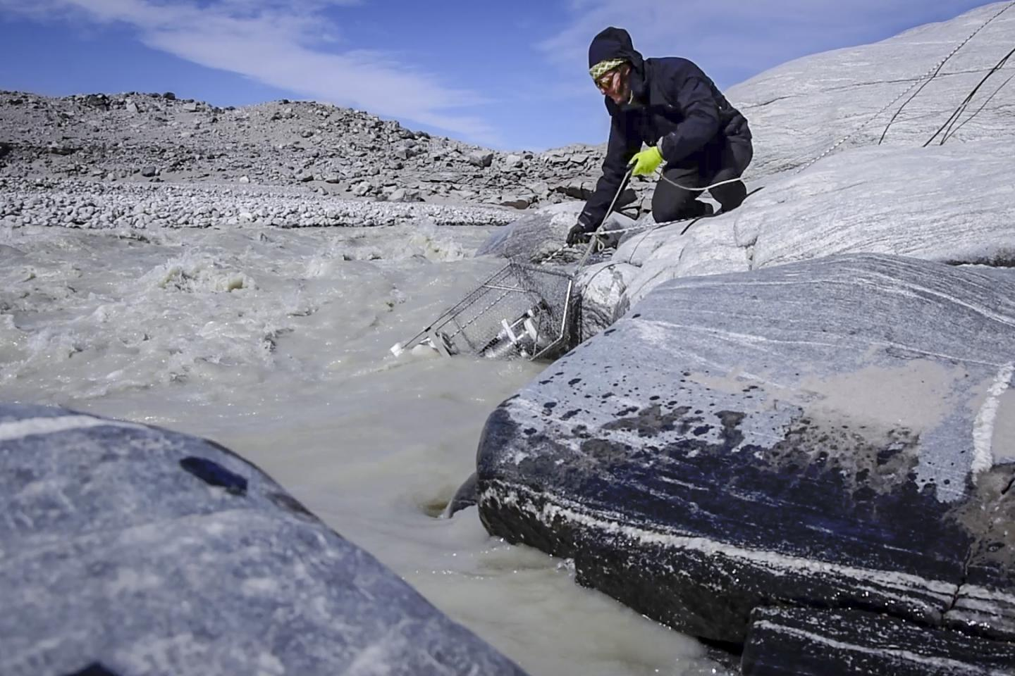 This is Guillaume Lamarche-Gagnon deploying the methane sensor that was used in the study into the proglacial river that drains the Greenland Glacier. / Credit: Marie Bulinova