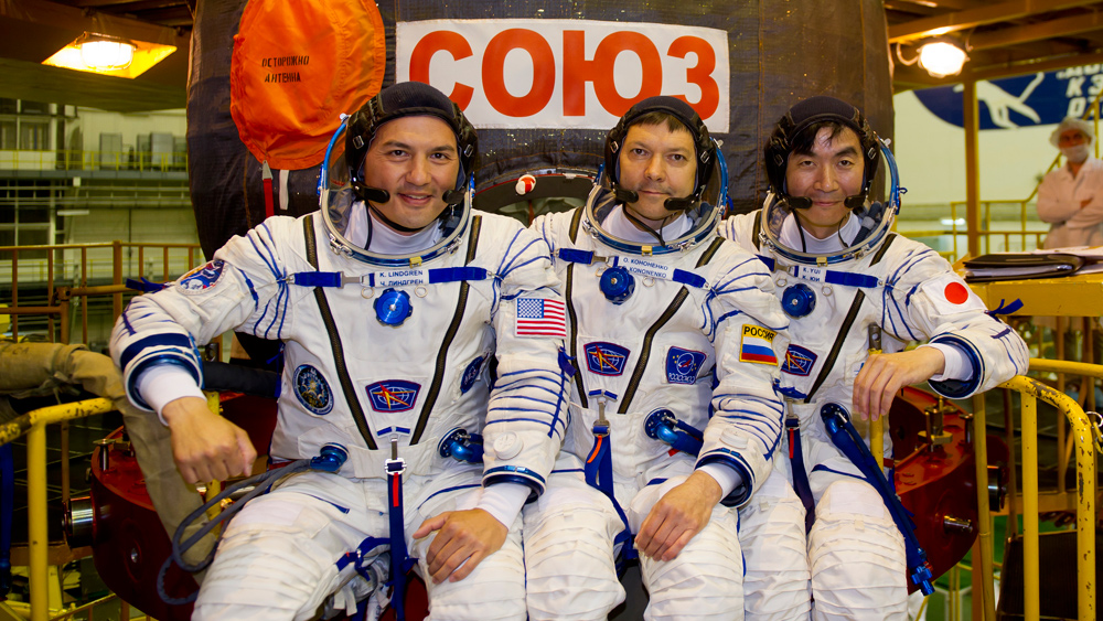 Three spacemen returned to Earth from the International Space Station on Friday.