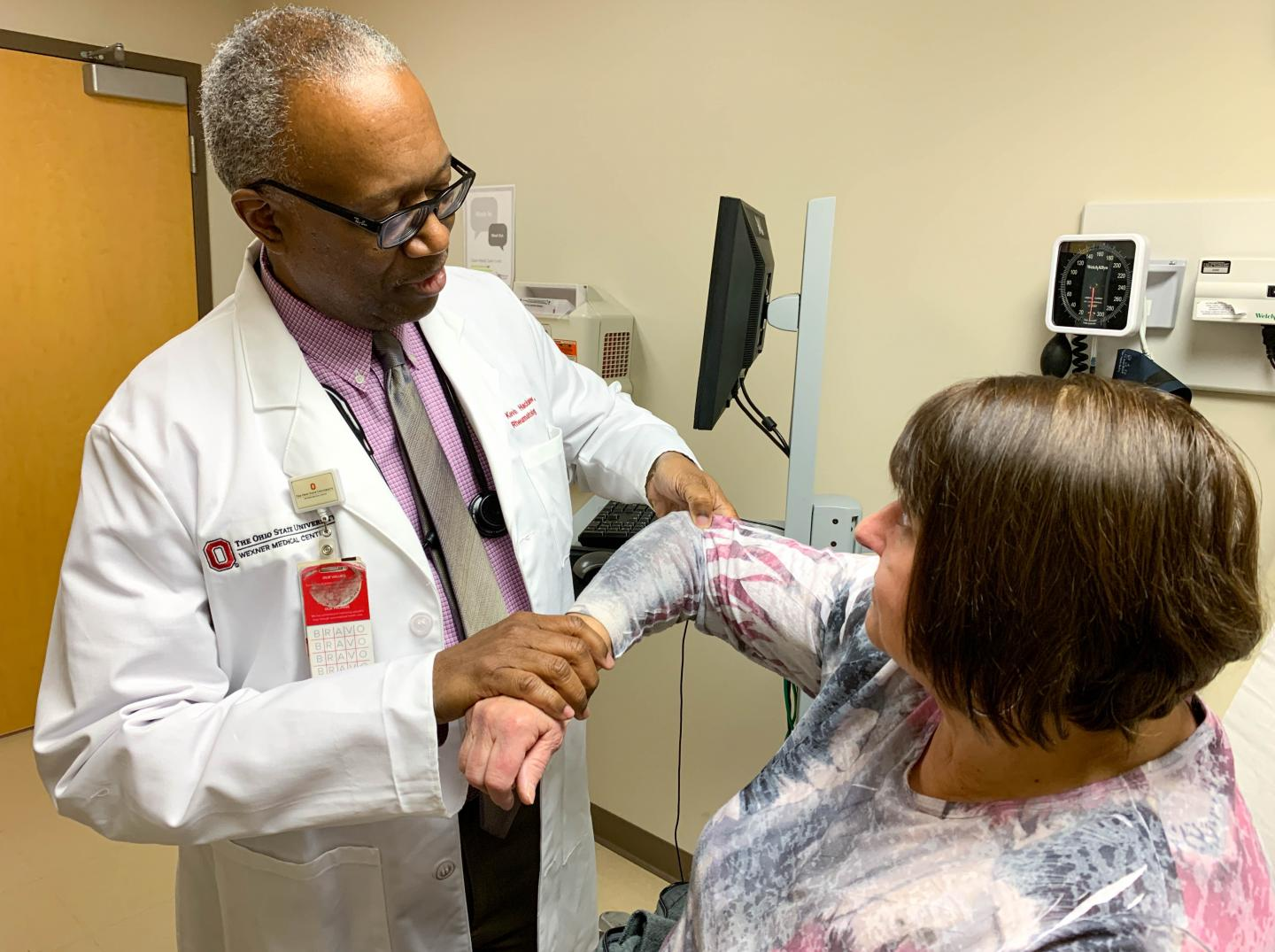 Dr. Kevin Hackshaw examines fibromyalgia patient Barb Hartong at The Ohio State University Wexner Medical Center. A new blood test may one day guide personalized treatment plans to relieve fibromyalgia pain. / Credit: The Ohio State University Wexner Medical Center