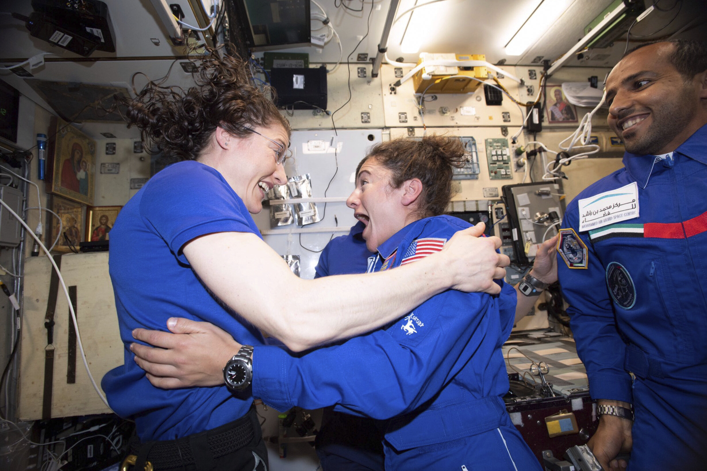 Christina Koch and Jessica Meir greet one another on the ISS.