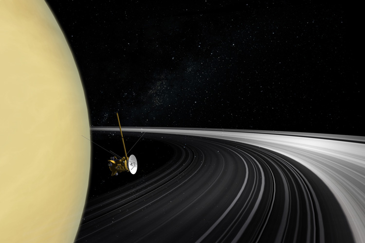 An artist's impression of the Cassini spacecraft in between Saturn and its planetary rings.