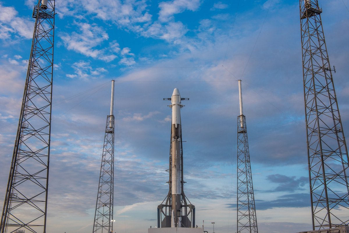 SpaceX's Falcon 9 rocket and Dragon capsule stand tall at a Cape Canaveral-based launch pad on Monday.