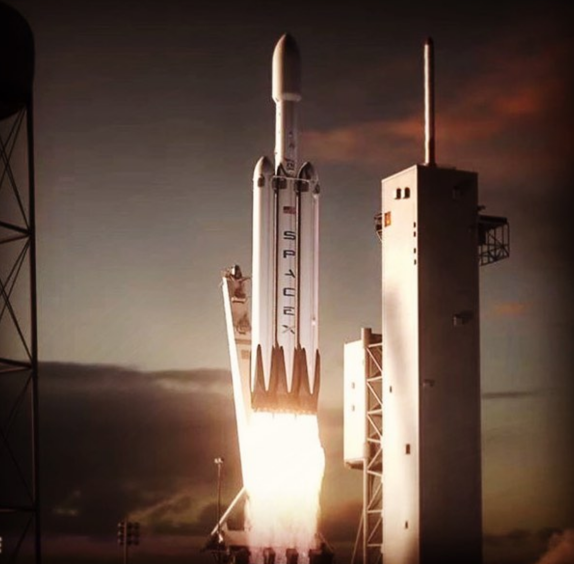 An artist's rendition of SpaceX's upcoming Falcon Heavy rocket mid-launch.