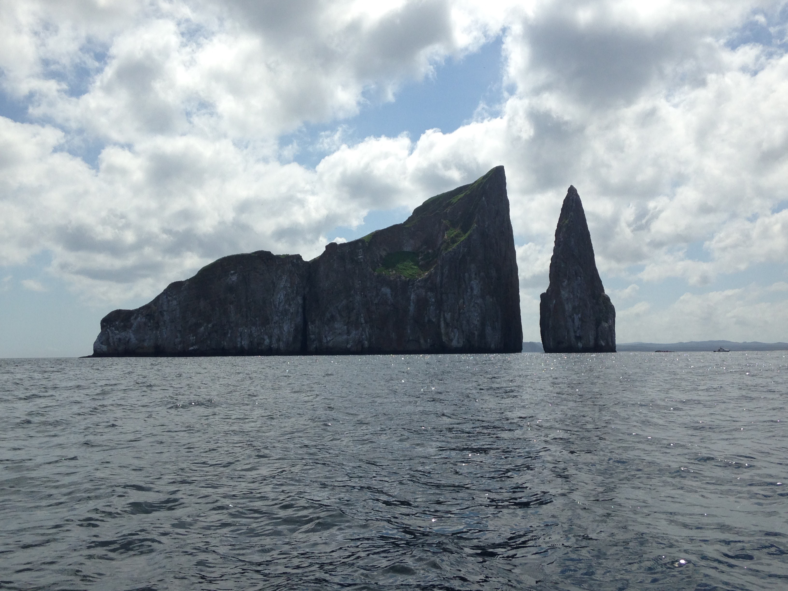 Marine rocks like this one, known as León Dormido or Kicker Rock, make up the Galapagos. Photo: Author