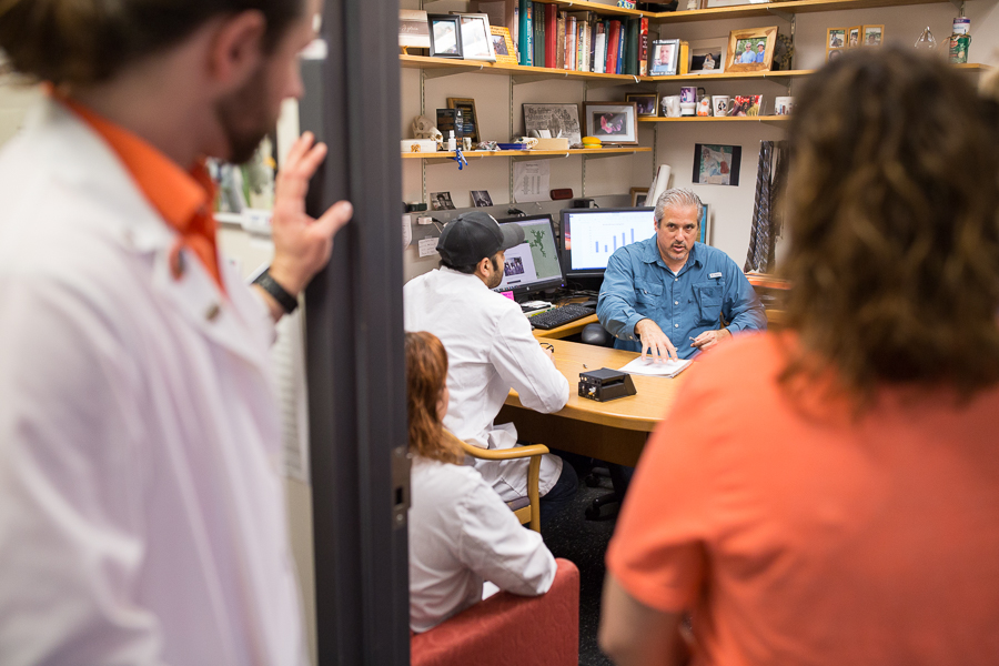 Matthew Gdovin discusses practices with his lab students. | Image credit: Scott Ball.