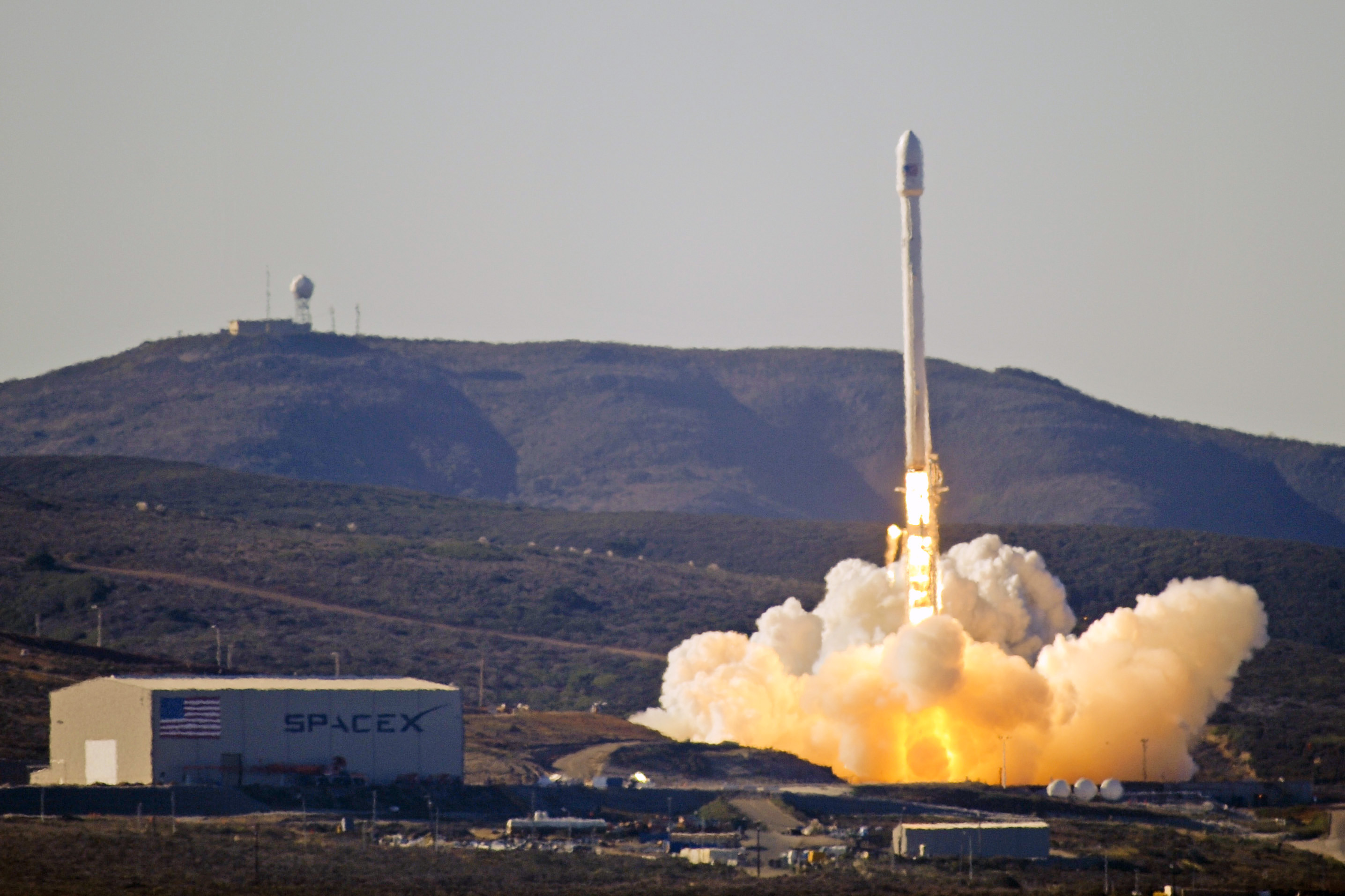 The original Falcon 9 rocket blasts off from the ground in 2013.