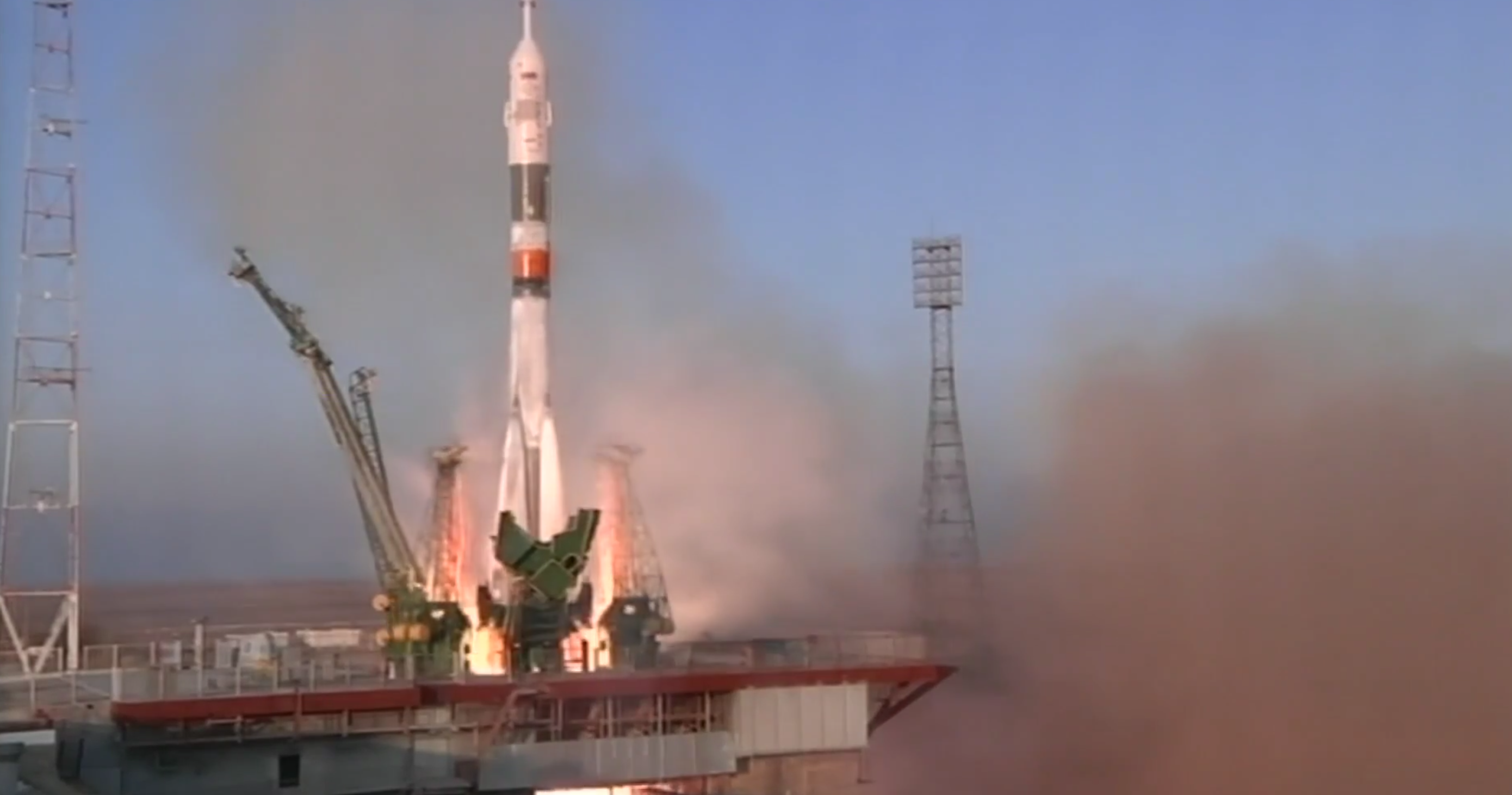 The rocket carrying Expedition 46 blasts off from the Earth.