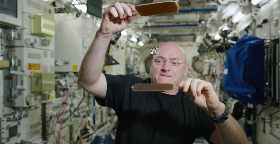 NASA's Scott Kelly plays Ping Pong in space with a ball of water.