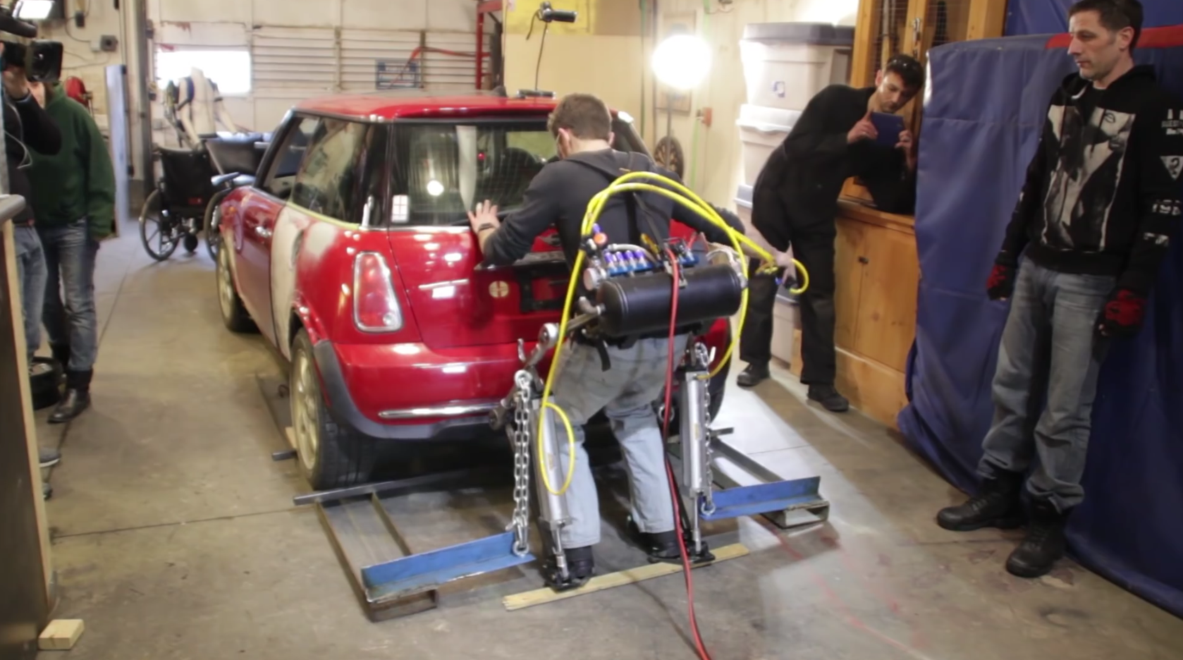 This homemade exoskeleton can pick up the rear end of a car..