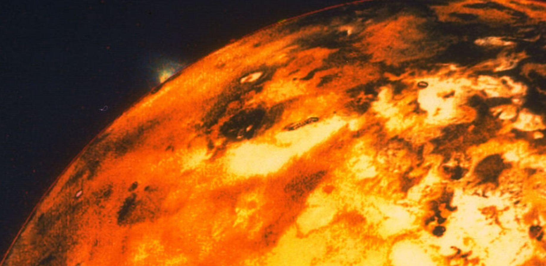 Io is a distant volcanic world that orbits Jupiter in our Solar System.