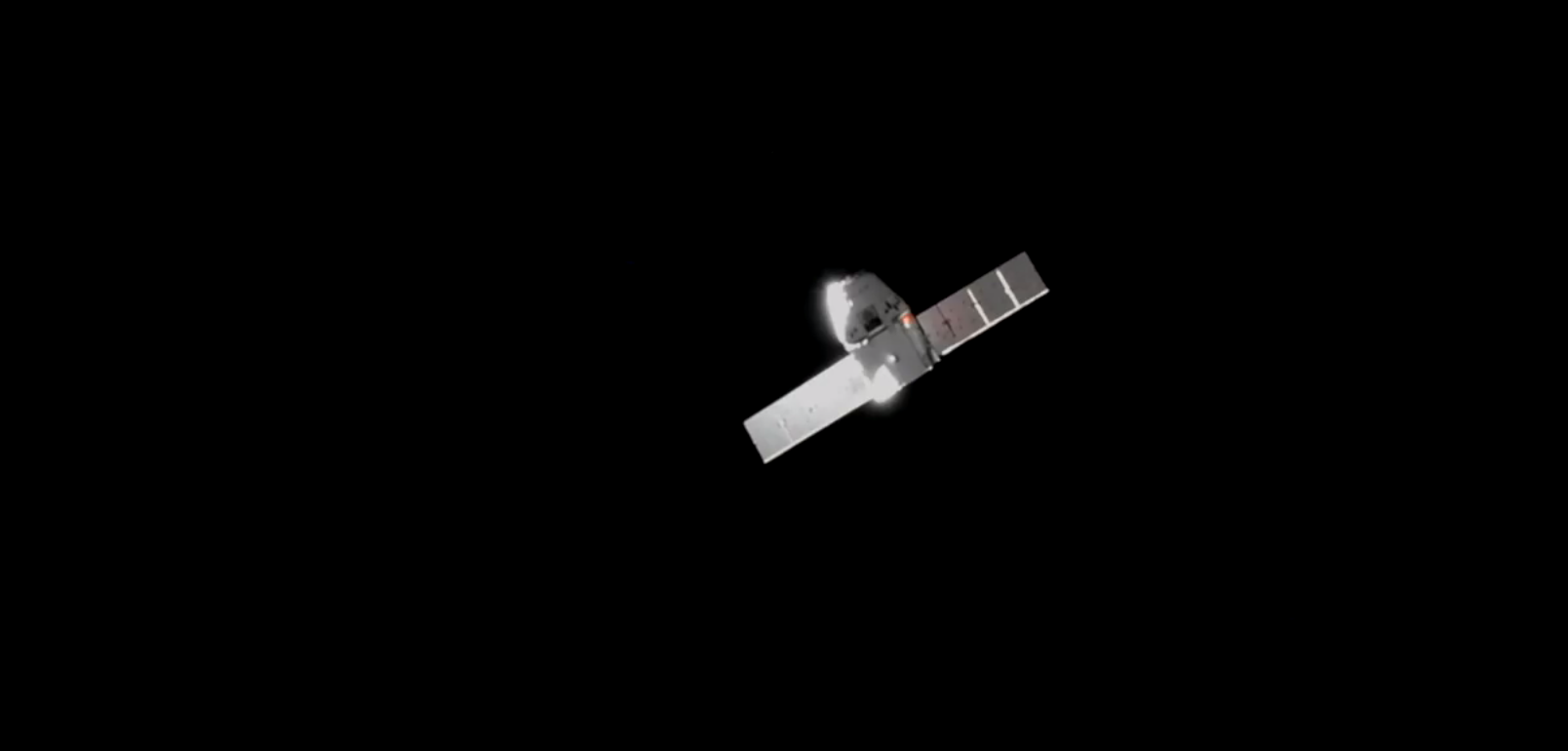 The SpaceX Dragon capsule approaches the International Space Station on Sunday.