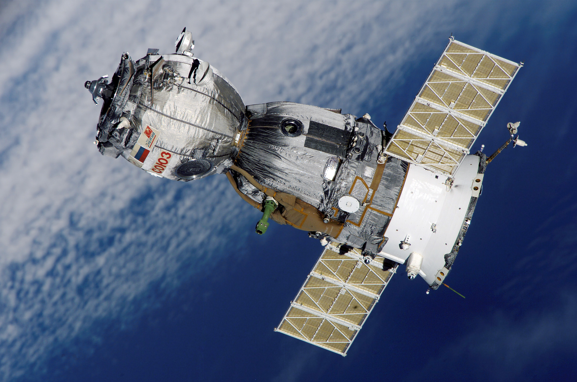 A Russian Soyuz spacecraft orbiting the Earth in space.