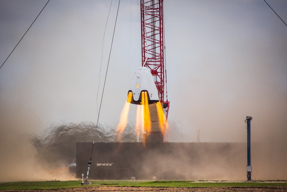 A SpaceX Crew Dragon capsule (formerly called Dragon 2) performing a hover test.