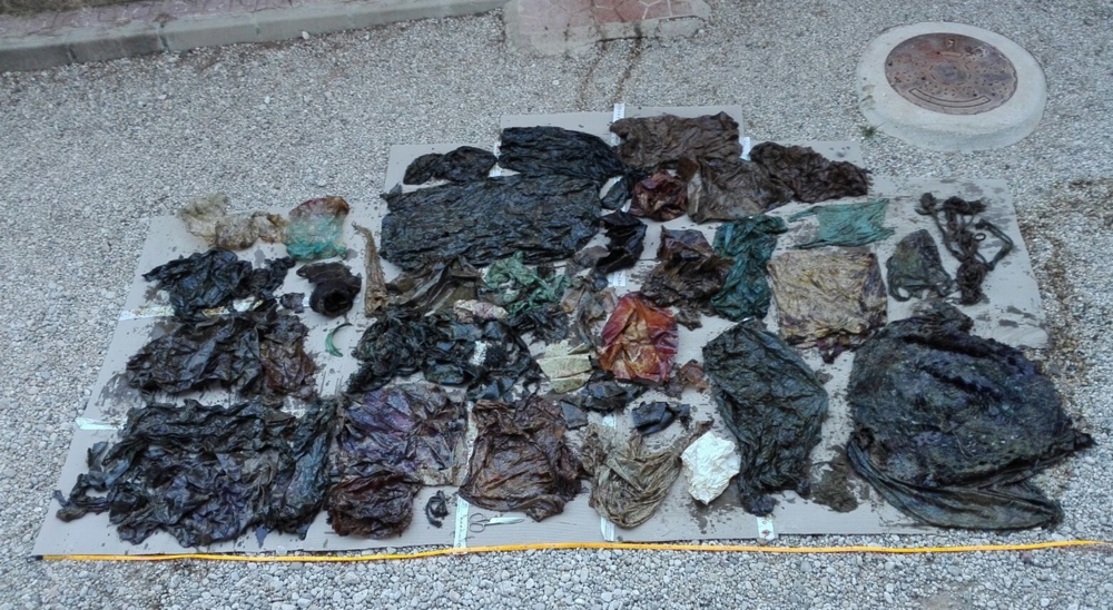 The trash extracted from the whale's digestive system is laid out for display.