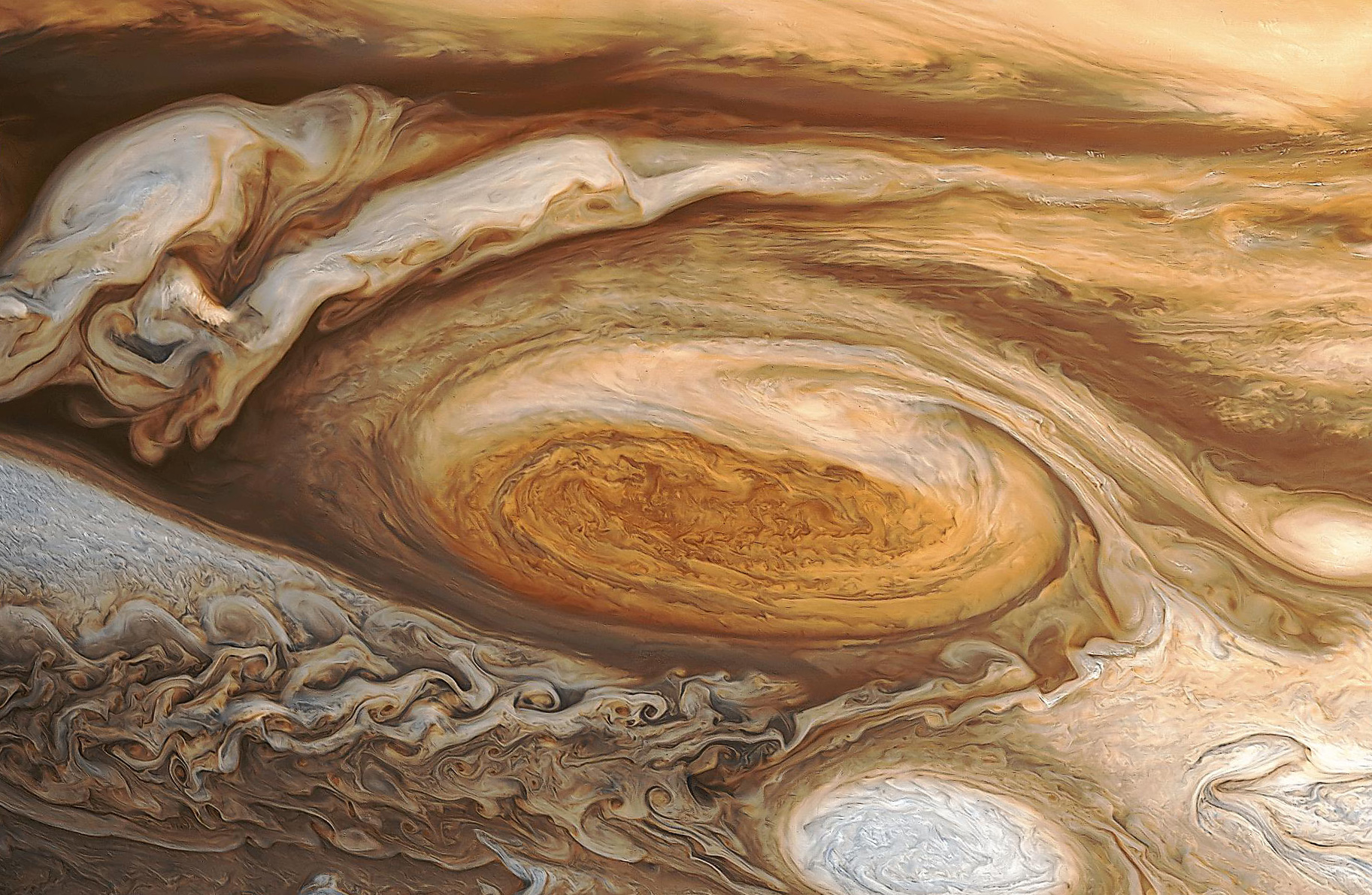 Jupiter's Great Red Spot may be the source of the planet's higher-than-expected atmospheric temperature.