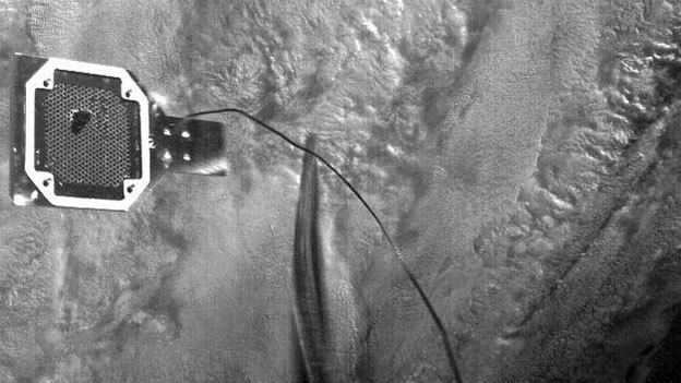 An image of the RemoveDEBRIS harpoon penetrating a simulated piece of space junk.