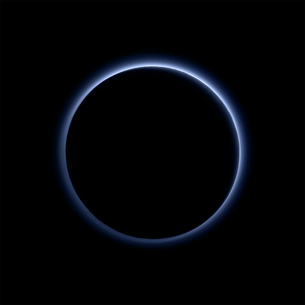 Pluto's atmosphere gives off a blue haze.