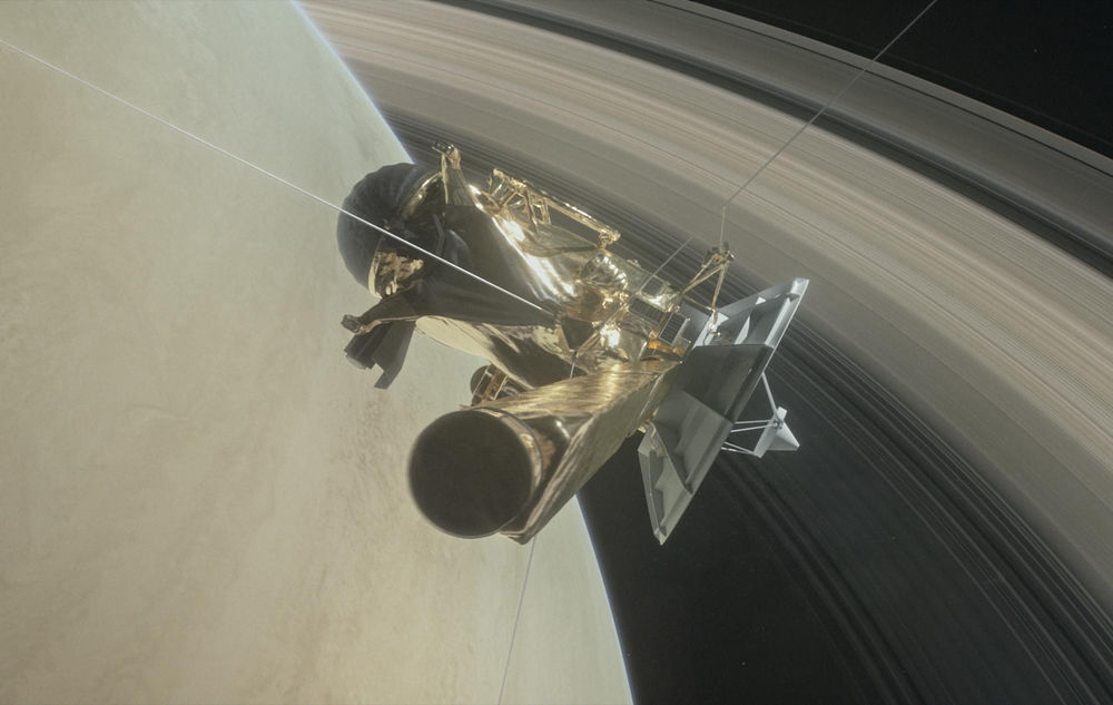 An artist's impression of the Cassini spacecraft flying in between Saturn and its rings to make observations.