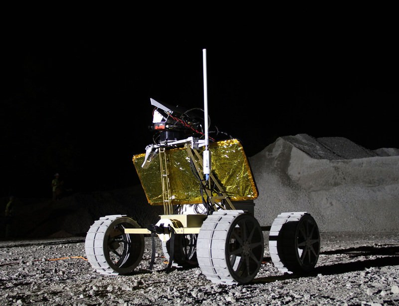 Creating a rover that can move across the Moon's surface and record HD video/photos is a requirement for the race.