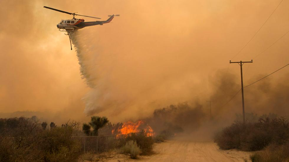 A helicopter makes a water drop at the Blue Cut wildfire. Photo: Jonathan Alcorn/ AFP/Getty Images