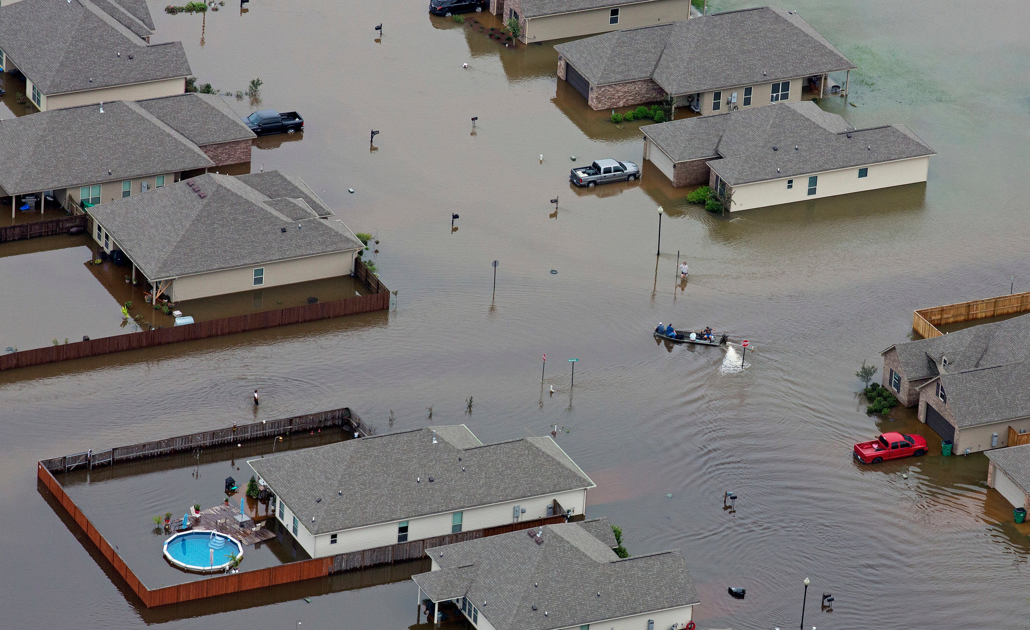 Boats motored along flooded streets in Hammond, La., on Saturday. Credit Max Becherer/FR 171354AP, via Associated Press..