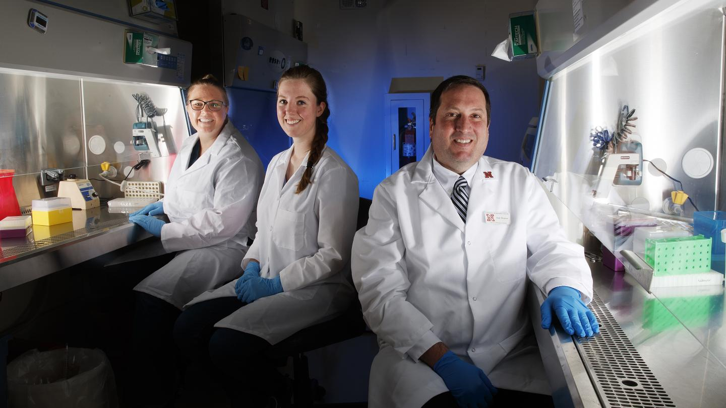 Eric Weaver (right), an assistant professor in the School of Biological Sciences at the University of Nebraska-Lincoln, and research team members Brianna Bullard (center) and Amy Lingel (left). / Credit: Craig Chandler/University Communication/University of Nebraska-Lincoln