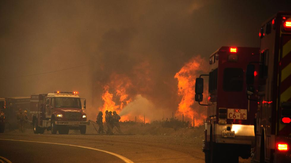 Firefighters attack the Blue Cut wildfire near Lytle Creek, CA. Photo: Robyn Beck/AFP/Getty Images