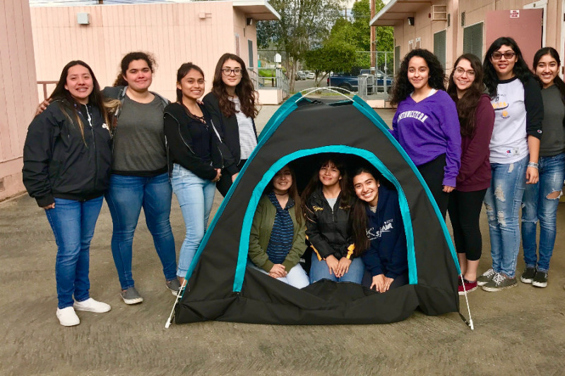 The girls show off their solar-powered tent. Source: GoFundMe