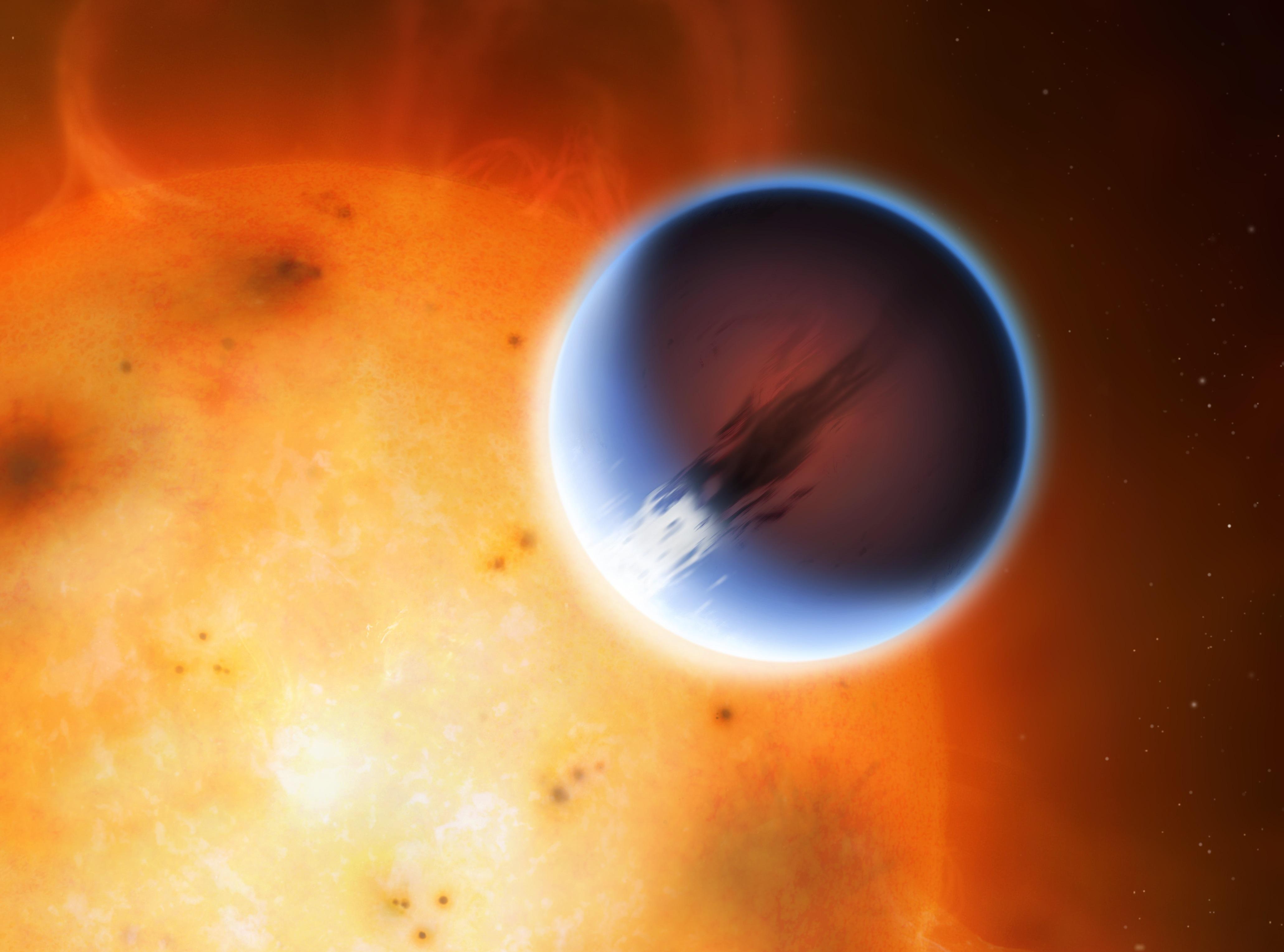 An artist's impression of HD 189733b orbiting its host star.