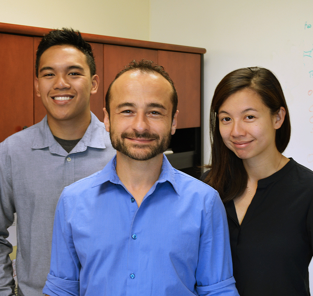 Authors of the new Scripps Research Institute study include (left to right) Justin Abadejos, Oktay Kirak and Manching Ku.