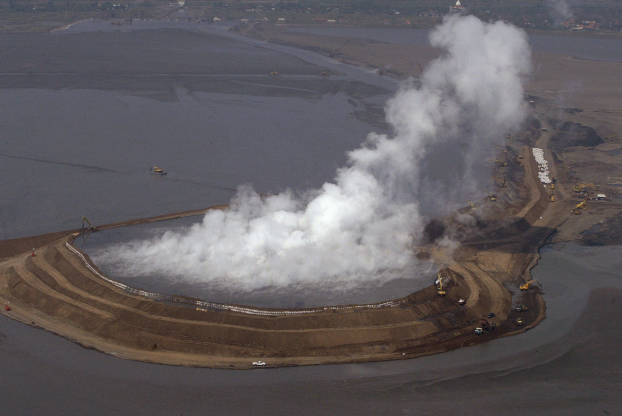 The Lusi eruption destroyed the surrounding area with constant floes of boiling mud. Photo: ABC