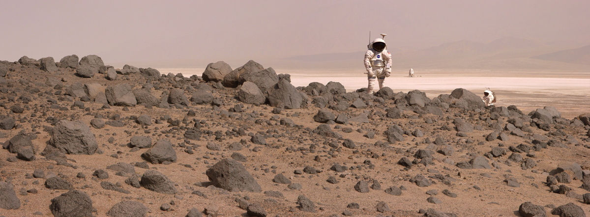 An artist's rendition of astronauts walking on the red planet.