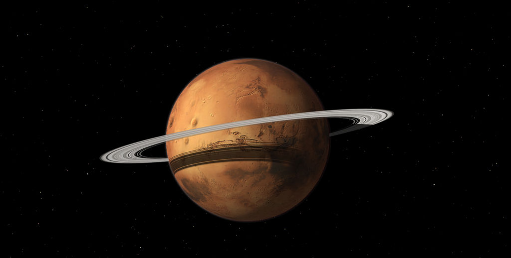 Mars might be slowly developing rings as a dust cloud continues to grow, researchers say.