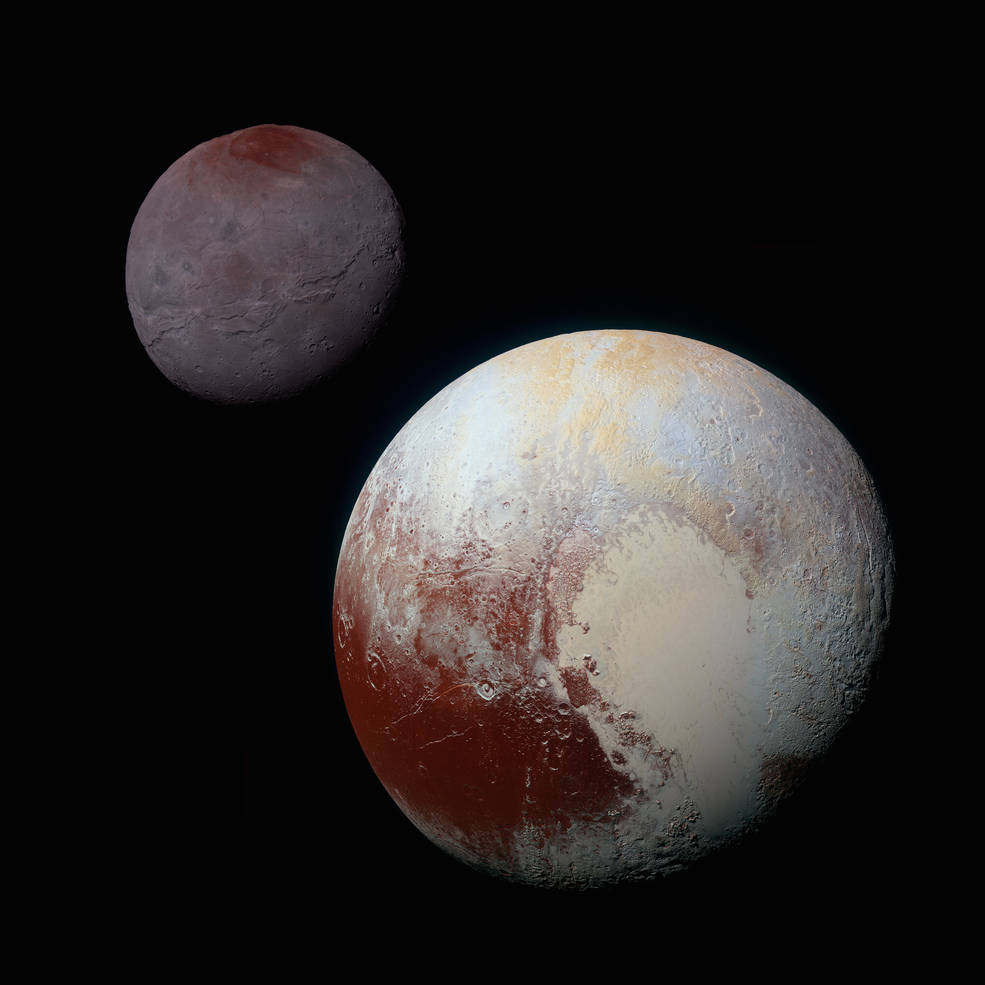 Here we see Pluto (right) and its largest moon Charon (left).