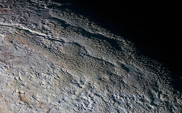 Pluto's surface shows signs of expansion.