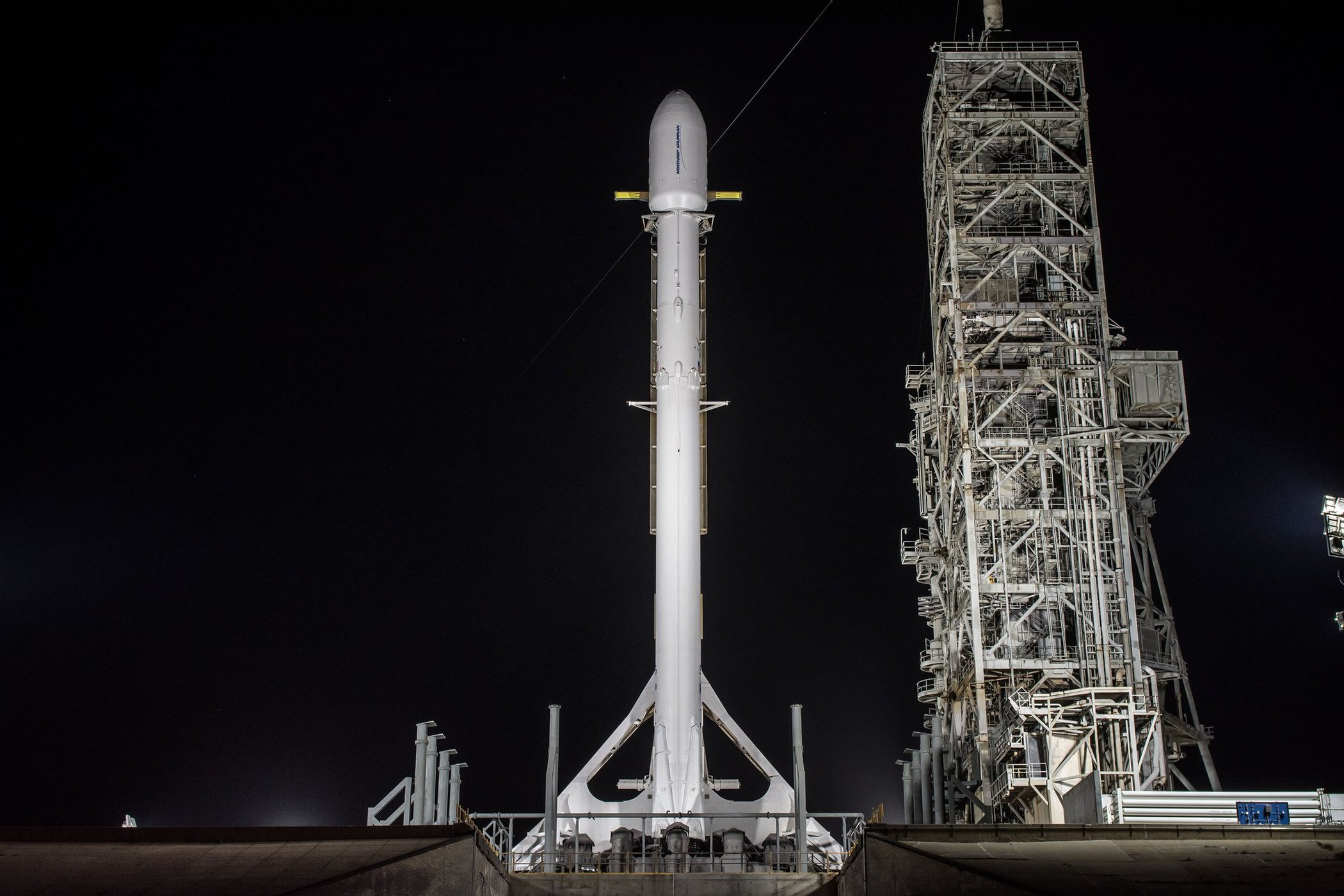 A SpaceX Falcon 9 rocket stands upright at NASA's Kennedy Space Center while carrying the top-secret Zuma payload.