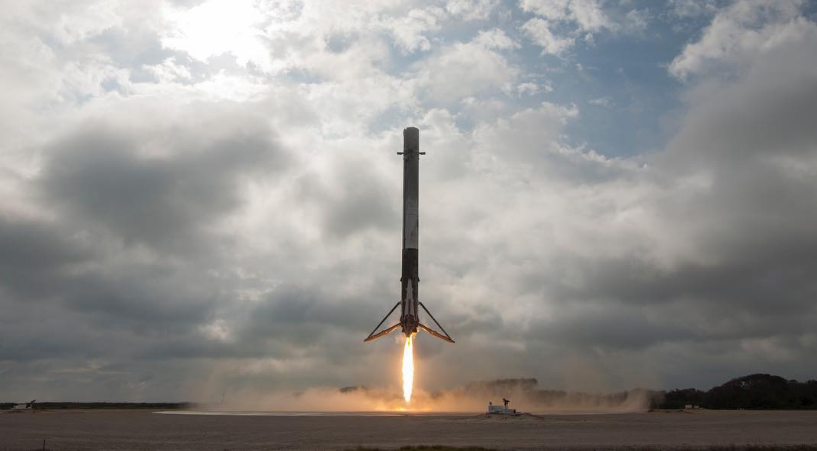 A SpaceX Falcon 9 rocket landing upright after flying to space.