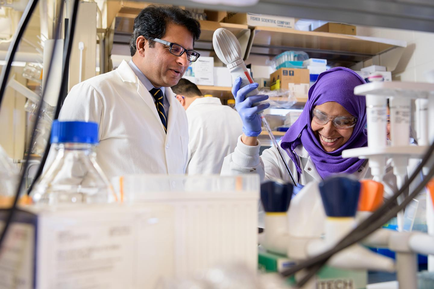 University of Delaware biologist Salil Lachke's research focuses on eye lens development. Here, he works in the lab with graduate student Salma Alsaai. / Credit: University of Delaware/ Evan Krape
