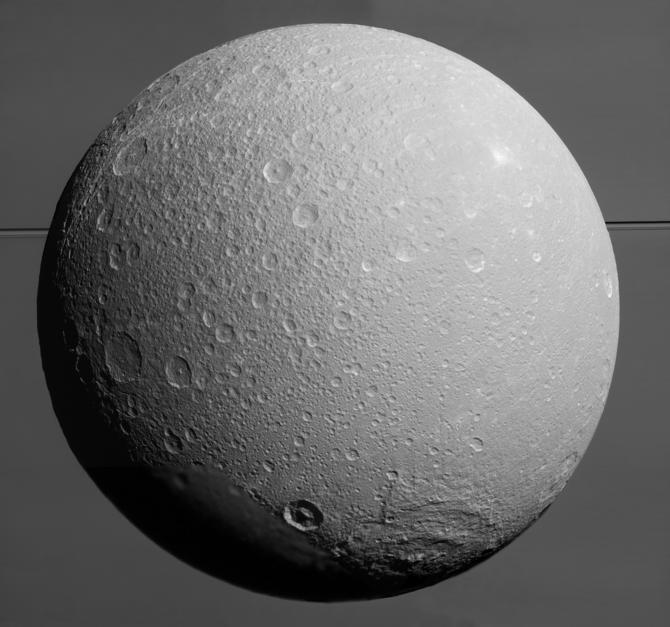 A close-up image of Saturn's moon Dione, as taken by NASA's Cassini spacecraft.